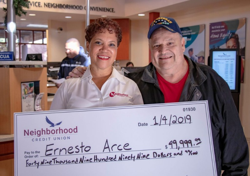 Man and woman holding large check