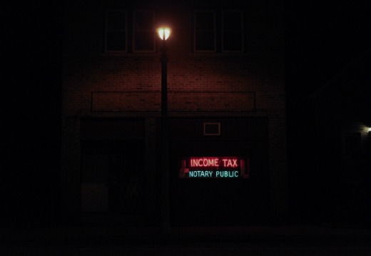 neon sign that says income tax