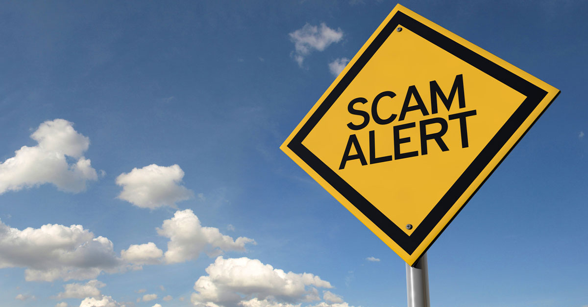 "still image of a clear blue sky with a yellow highway sign with the words ""scam alert""."