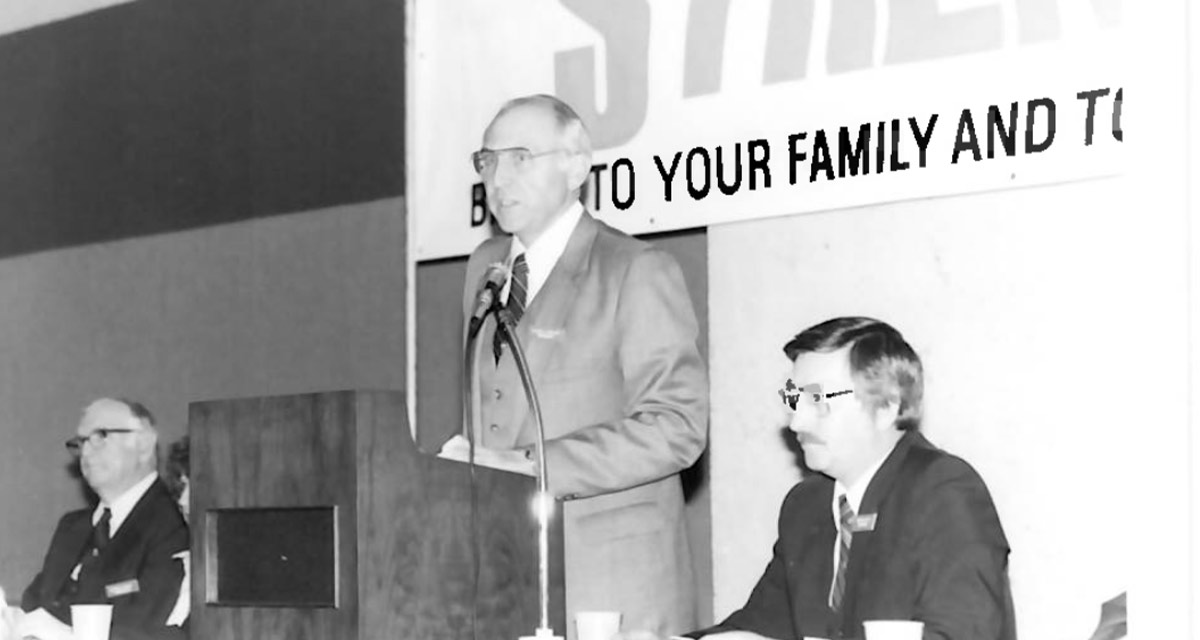 Black and White image of former CEO and President, Calvin Phillips, speaking at a Dallas Postal Credit Union annual meeting