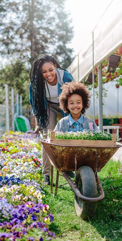 Woman and girl in a flower nursery