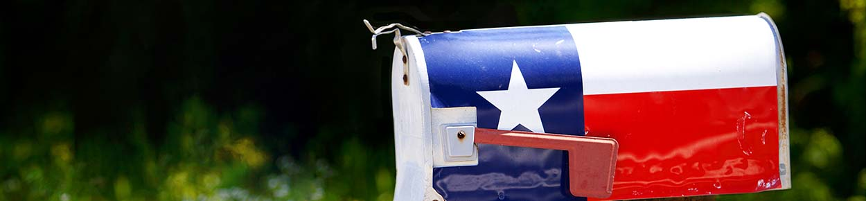 Texas state flag painted on mailbox