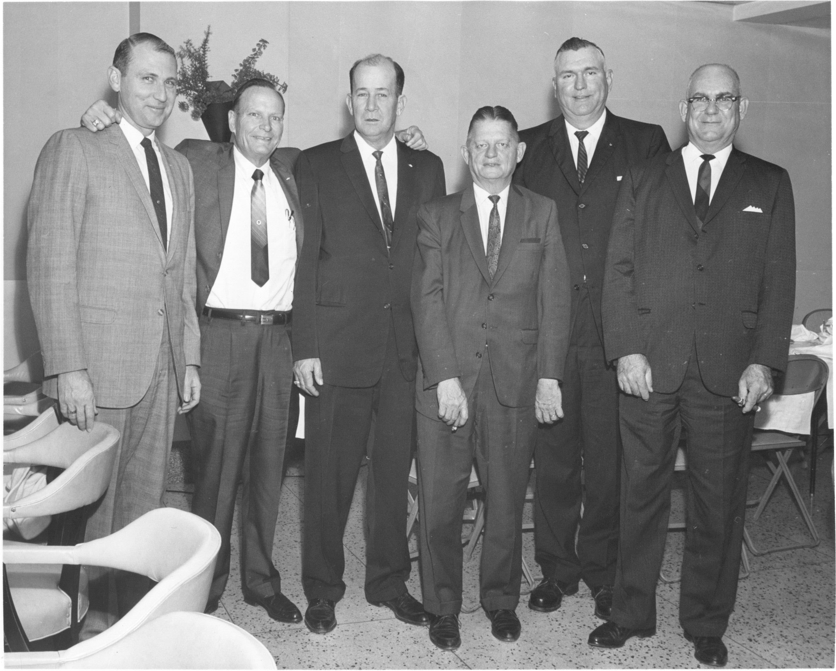Group of men in suits and ties